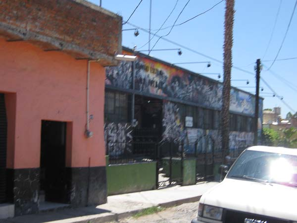 The building with the mural on it is the local grade school.  The school is a block away from our house and we pass it each time we walk to the town plaza.