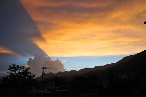 Sunset and clouds.  Notice how the shadow of one clould can be seen on the other.  Amazingingly beautiful.