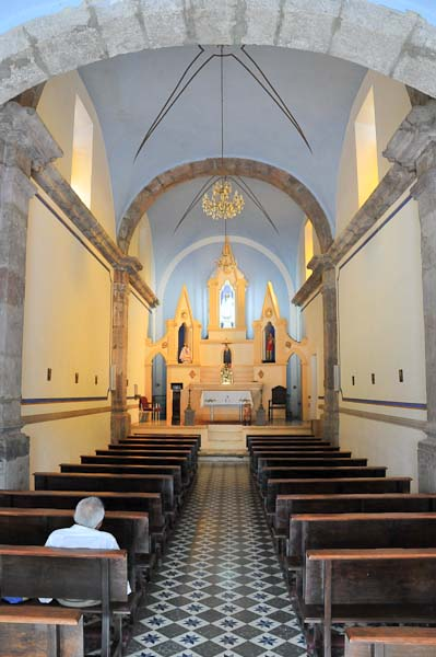 The interior of the ancient church in Ajijic's town square still used by the faithful of the village.