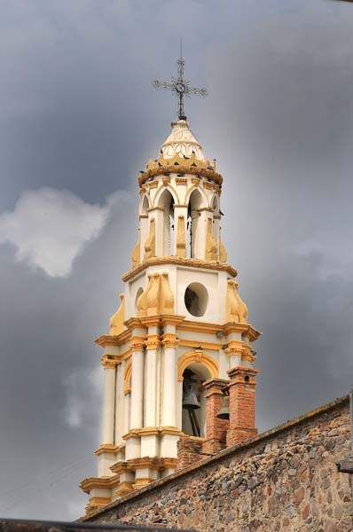 Ajijic has had some heavy clouds and rain probably connected to the storms in the gulf.  Though David has taken a similar photograph in the past, this turned out so well it is worth sharing.  He caught the sunlight on the church steeple with the dark storm clouds behind capturing the contrast so well.