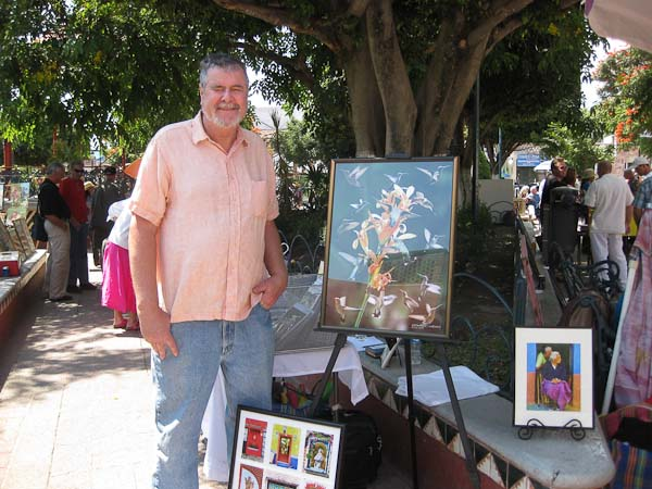 David at the art show on the square with some of his work.