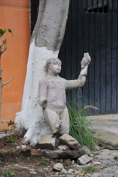 Mexican sculpture removed from house being remodeled.