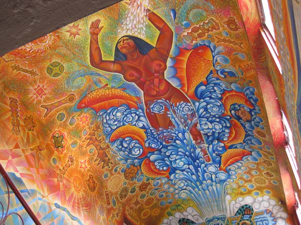 More of th mural on the walls and ceiling surrounding the stairwell.